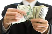 Business money in hands — Stock Photo