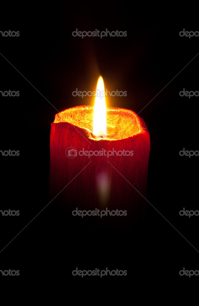 Burning wax candle on a black background  Stock Photo #1015039