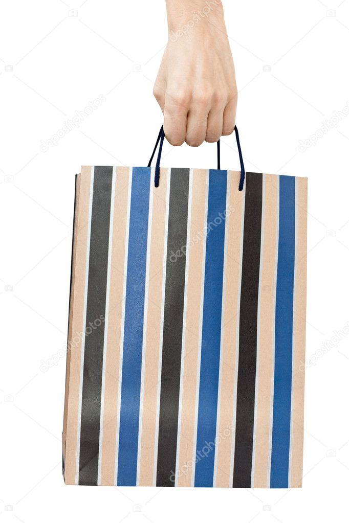 Striped color shopping bag with hand isolated on white background  Stock Photo #1028960