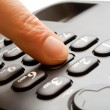 Royalty-Free Stock Photo: Dialing - telephone keypad with finger