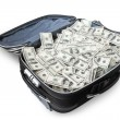 Stock Photo: Lot of money in suitcase