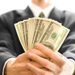 Деньги в руки бизнесмен — Стоковое фото #1036735