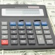 Calculator with money — Stock Photo