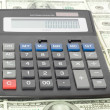 Stock Photo: Calculator with money