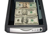 Dollars in the scanner — Stock Photo