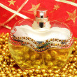 Bottle of Perfume on a red background - Lizenzfreies Foto