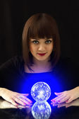 Girl and a magic ball — Stock Photo