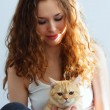Girl and a British cat — Stock Photo