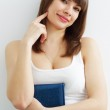 Girl with book on a gray background — Stock Photo