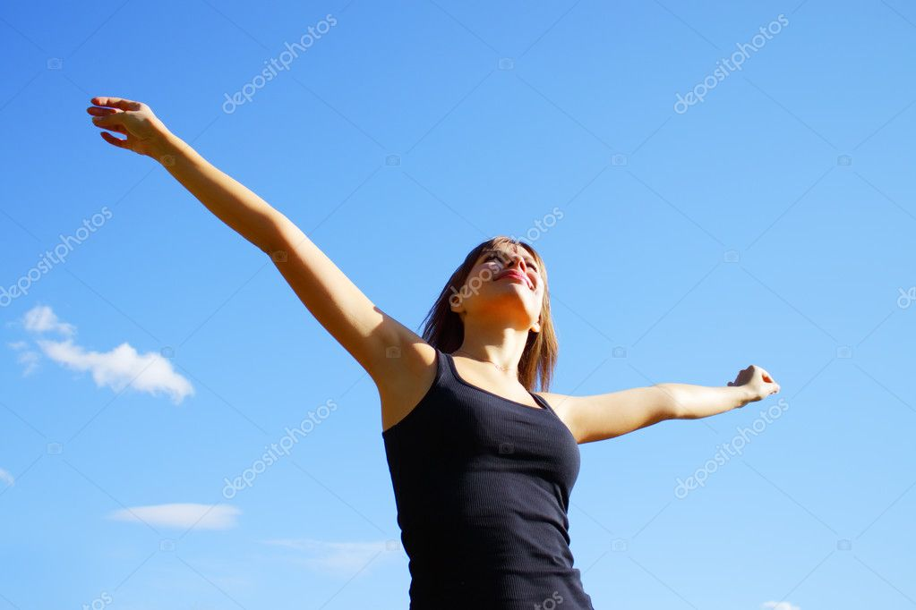 Girl on a background of blue sky — Stock Photo #2416535