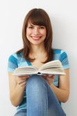 Girl holds a book — Stock Photo