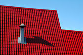 Red roof from a metal tile — Stock Photo