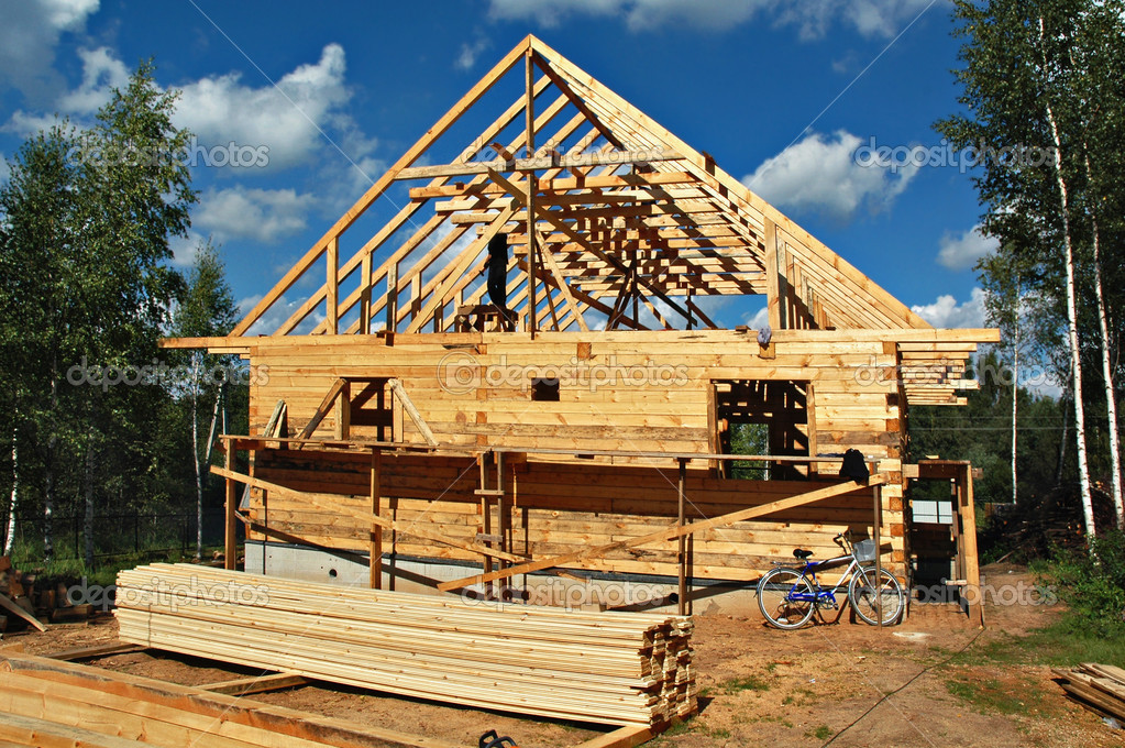 Construction of the country house from a bar on a country site  Foto de Stock   #1053318
