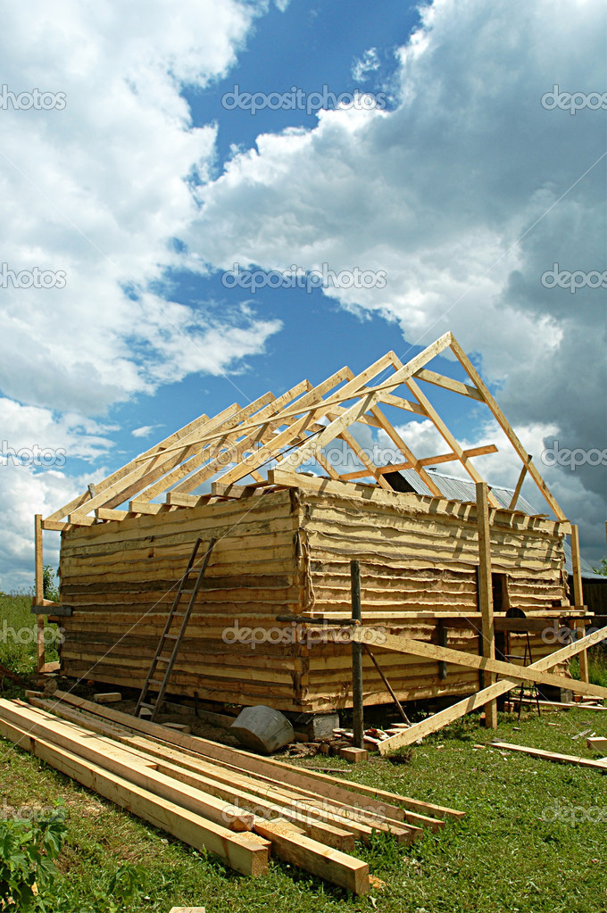 Building of a bathhouse from a bar on a country site against the sky with clouds — Stock Photo #1054664
