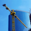Crane and building office — Stock Photo