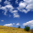 Stock Photo: Hillside and sky with clouds