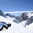 Ski goggles with reflection of mountains — Stock Photo