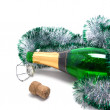 Bottle champagne and Christmas tinsel - Stock Photo
