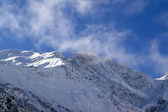 Donguzorun in clouds. Caucasus Mountains — Stock Photo
