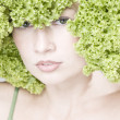 Girl with lettuce hairdo — Stock Photo