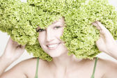 Girl with lettuce green bow — Stock Photo