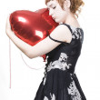 Girl with heart-shaped balloons — Stock Photo