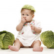 Baby with cabbage — Stock Photo