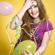 Girl with balloons and paper streamer - Stock Photo