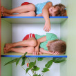 图库照片: Tired kids in closet