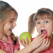 Royalty-Free Stock Photo: Kids playing with apples
