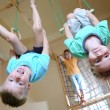 Children hanging on gymnastic rings — Stock Photo