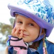 Smiling child wearing protective helmet - Stock Photo