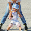 Family rollerblading — Stock Photo #1006452