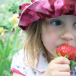 Stock Photo: Eating sweet strawberry
