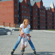 Family fun rollerblading — Stock Photo #1006631