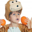 Monkey child with oranges — Stock Photo #1006733