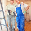 Smiling plasterers — Stock Photo