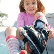 Stock Photo: Child putting on her rollerblade skate
