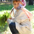 Royalty-Free Stock Photo: Autumn fashion leaves child