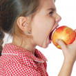 Royalty-Free Stock Photo: Girl biting an apple