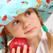 Girl with hat and apple — Stock Photo