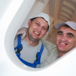 Two smiling construction workers — Stok fotoğraf