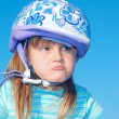 Grimacing girl with a helmet — Stock Photo