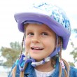 Photo: Happy girl wearing helmet