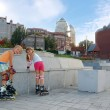 Kids on roller blades in the park — Stock Photo