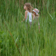 Kids walking in grass — Stock Photo #1007459