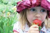 Eating sweet strawberry — Stock Photo