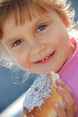 Child eating a bun — Stock Photo