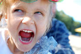 Angry child face — Stock Photo