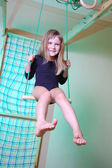 Child palying with home gym — Stock Photo